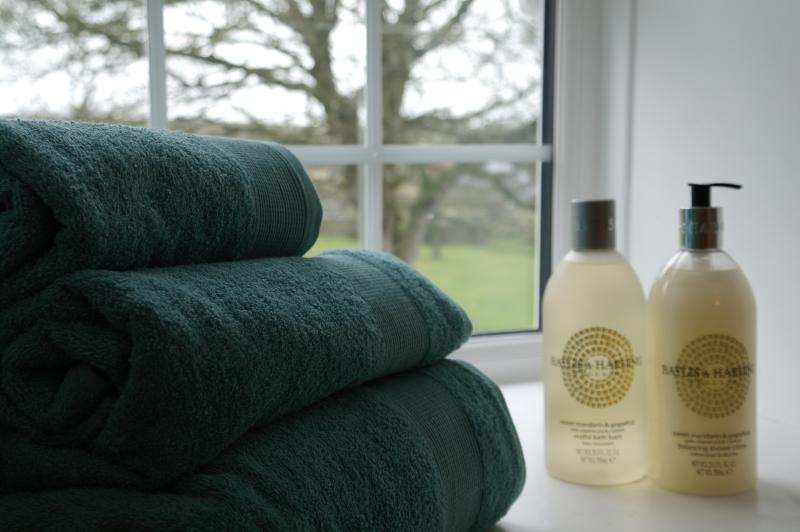 Bundles of soft towels and quality soaps and bath products