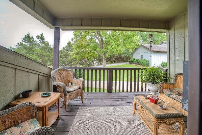 Escape to the private deck off the master bedroom of this vacation rental home.