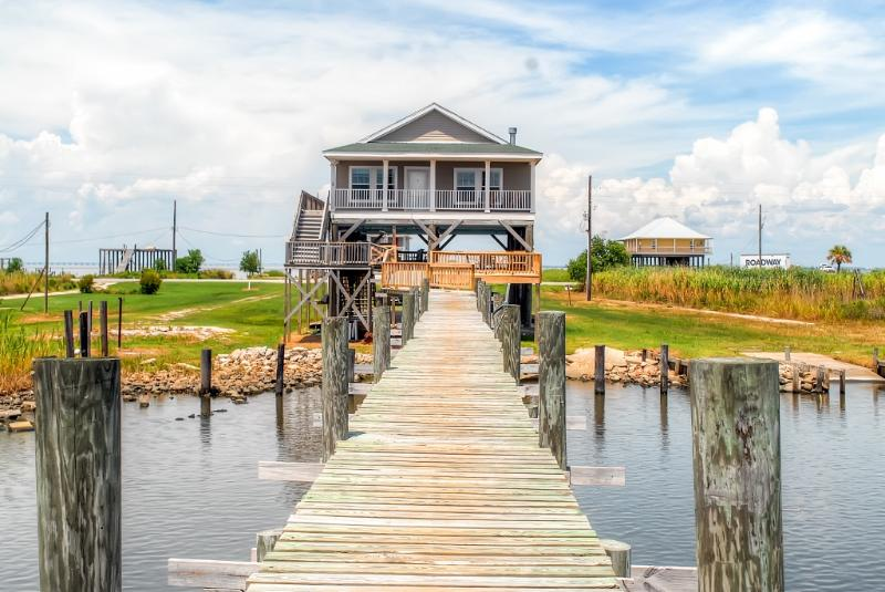 This amazing New Orleans vacation rental home is ideally situated on beautiful Lake St. Catherine!
