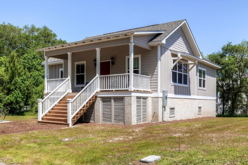 This house sits on a large lot surrounded by marshland, lush trees, and beautiful views.