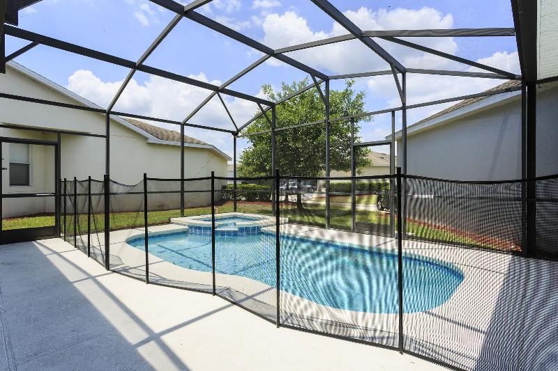 Pool is equipped w/ child safety fence for when pool is not in use