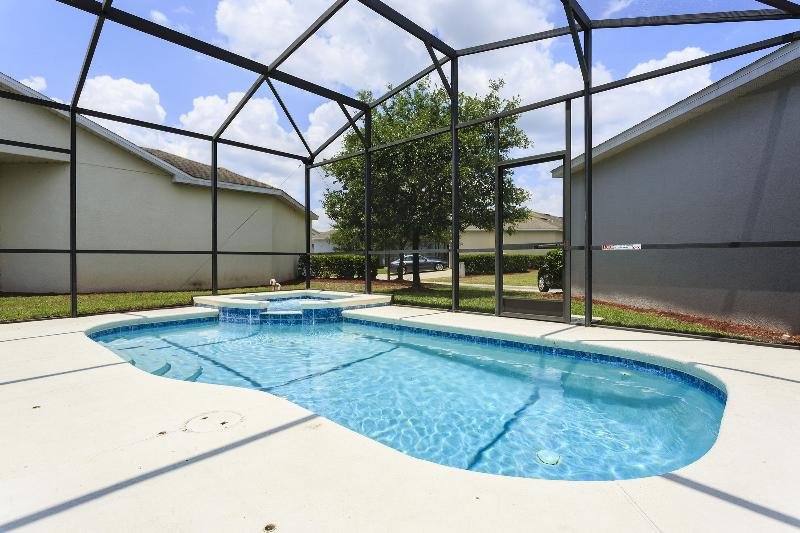 Private inground pool with hot tub