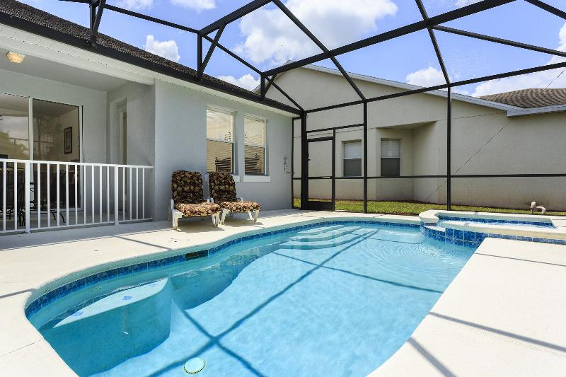 Pool with enclosed lanai & pool side seating