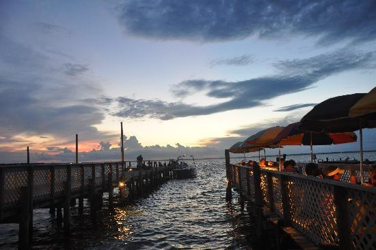 Have a sunset dinner on the dock at Dewey Destin