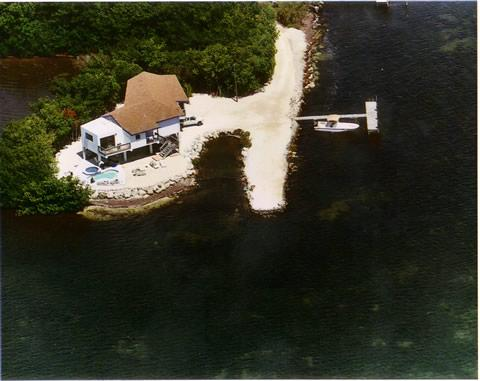 completely private surrounded by water on all sides apart the driveway entrance