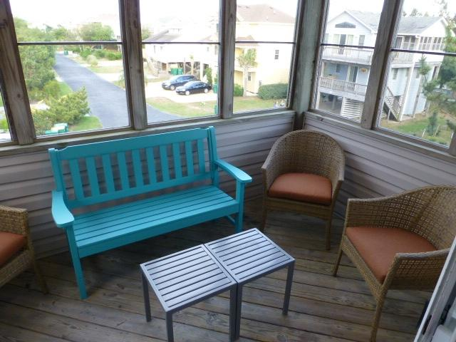 Screened porch on top floor with seating for 6, tables, fan and lighting.