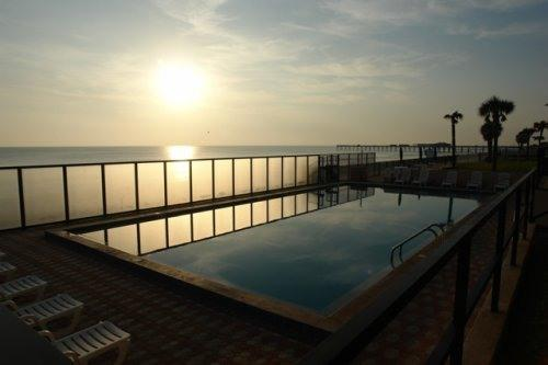 Sunrise View over Pool and Beach