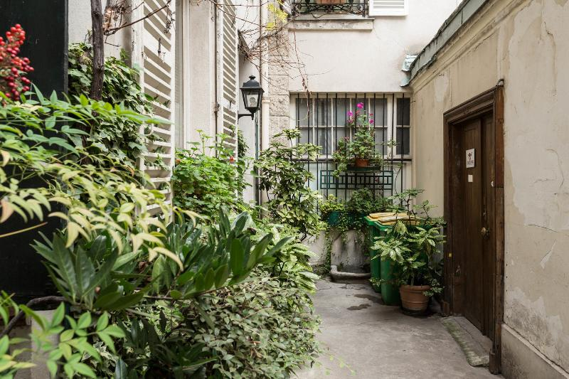 Typical Parisian Courtyard leading to your home away from home!