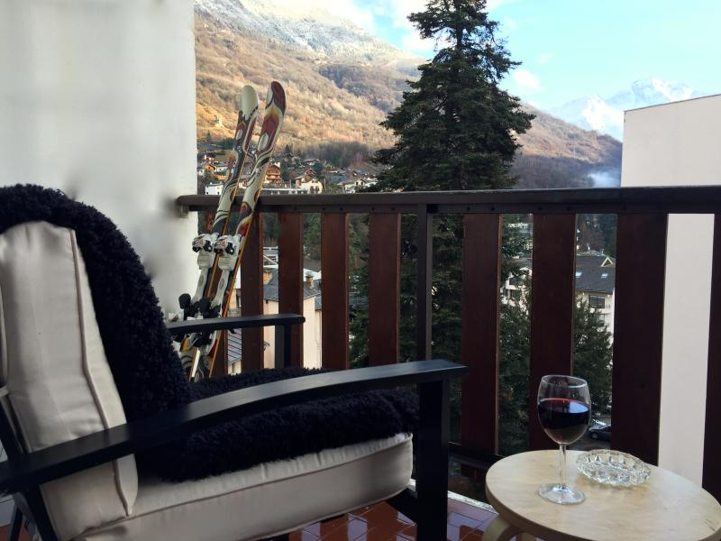 Enjoy a glass of wine on the balcony with views of the town and mountains beyond