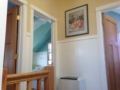 top of stairs with bedroom entrances