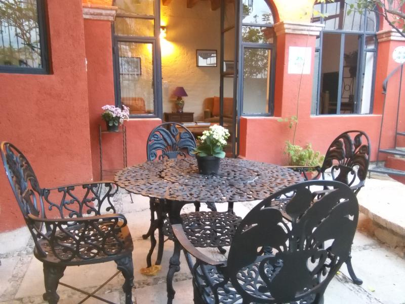 Casita opens out onto patio garden with lime tree  and table with seating for 4