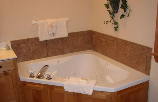 Every Bathroom has a Jacuzzi Tub and Tiled Shower
