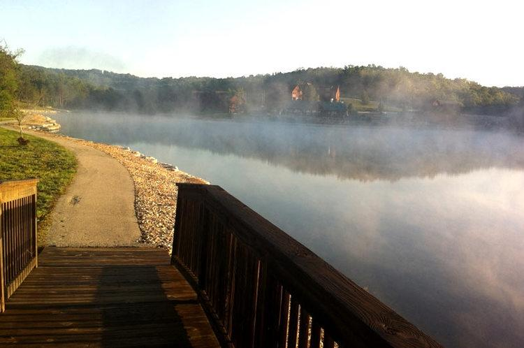 Fox Hollow Lake is surrounded by a paved walkway with quaint foot bridges.