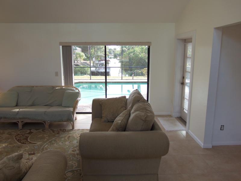 Great room looking out to the pool and canal