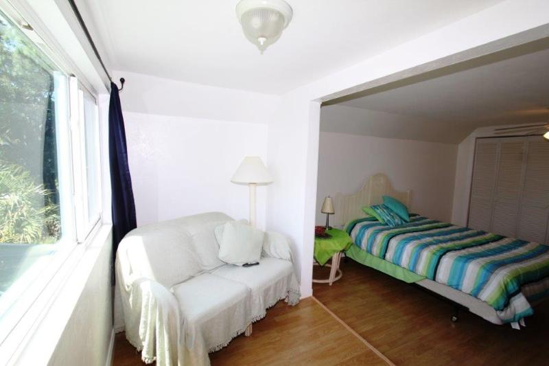 upstairs bedroom overlooking pool and canal