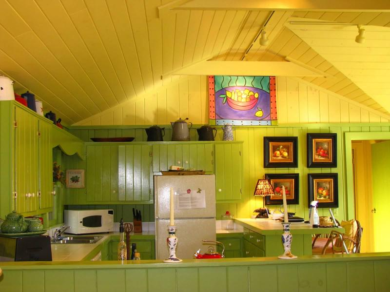 Enjoy quiet mornings in this brightly colored kitchen