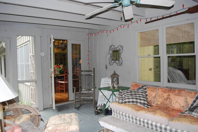 Roomy and relaxing screened in porch