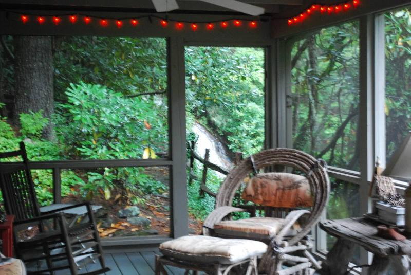 Enjoy the sounds of the waterfall from the screened-in porch