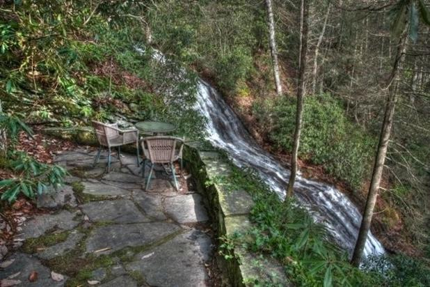 This breathtaking waterfall is only a few steps from the screened in porch.