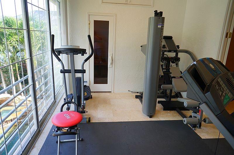 Sauna and indoor gym (next to master bedroom) overlooks canal and back yard pool
