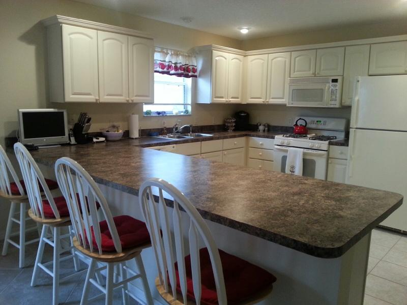 Open kitchen with island seating for 4