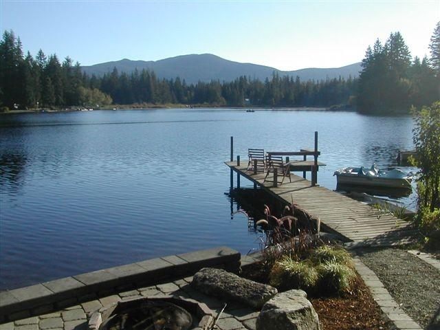 Lake front ;patio and dock with view of Squawk Mountaion