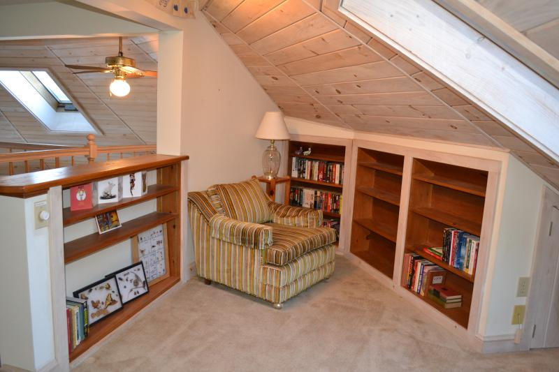 Reading Nook in Loft with plenty books, board games and hang out for the kids.