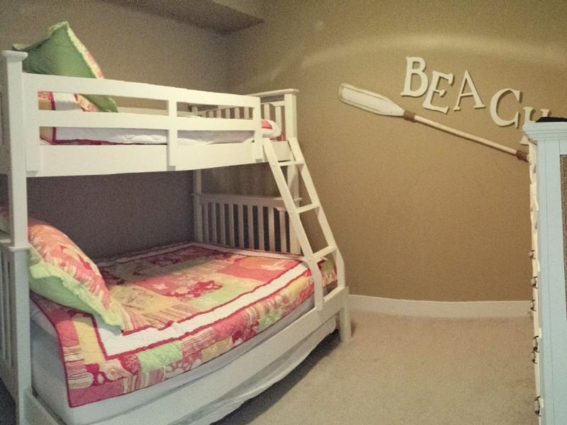 Bedroom 3 with bundle (twin on top, full below) and 1 twin roll out bed on bottom of bundle.