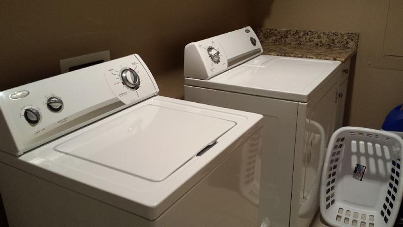 Laundry room: full size washer and dryer.
