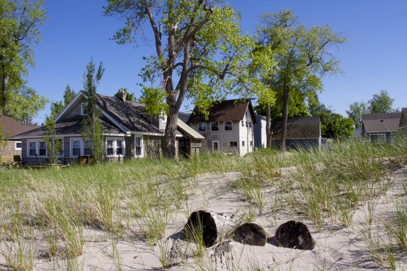Cottage is center middle, tan home as viewed from beach.