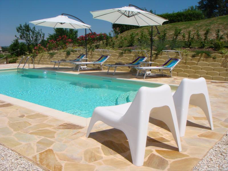 Relax by the pool at Villa Miramonti