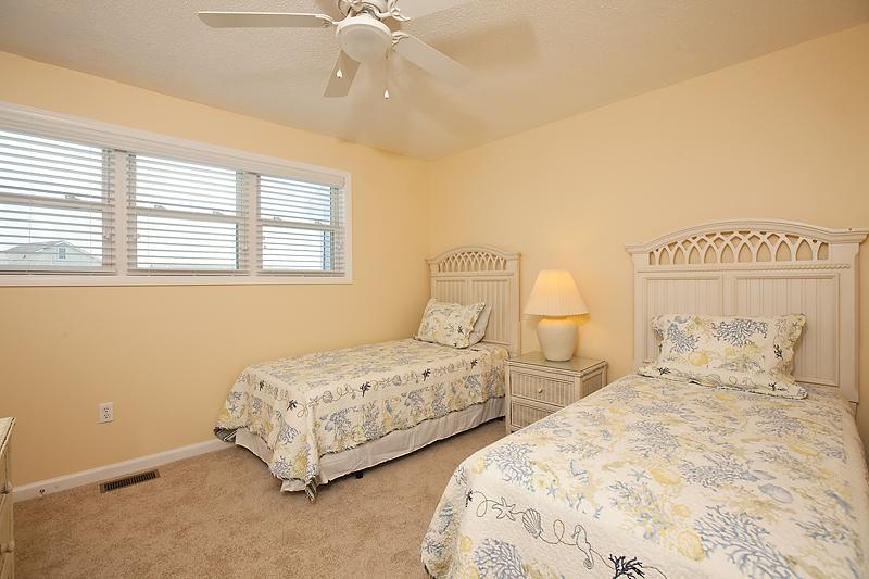 Second upstairs bedroom with 2 twin beds and dresser.