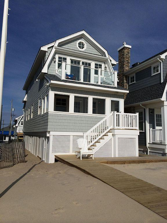 Front of the house looking from the boardwalk. Note  balcony & porch.