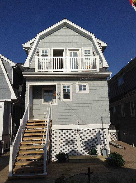 Back view of house, facing street and garage apartment. See upstairs balcony.