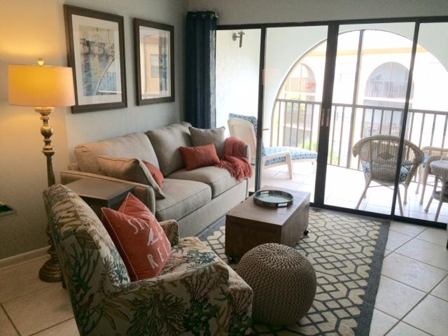 Lanai with a small table and lounge chair to enjoy a book or coffee & newspaper