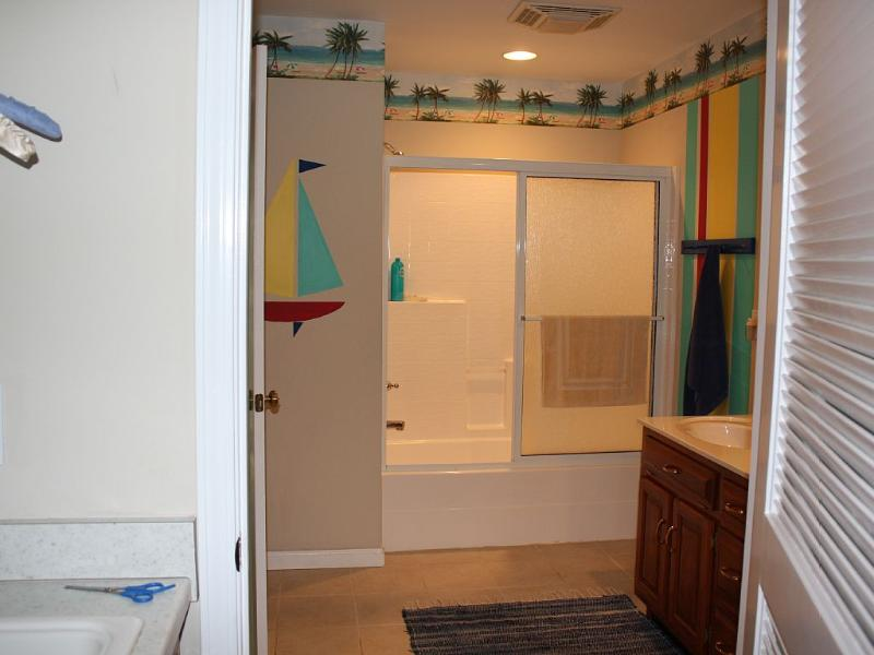 Upper level bathroom has 2 sinks.  Laundry room off the bath, 2 dryers & washer.