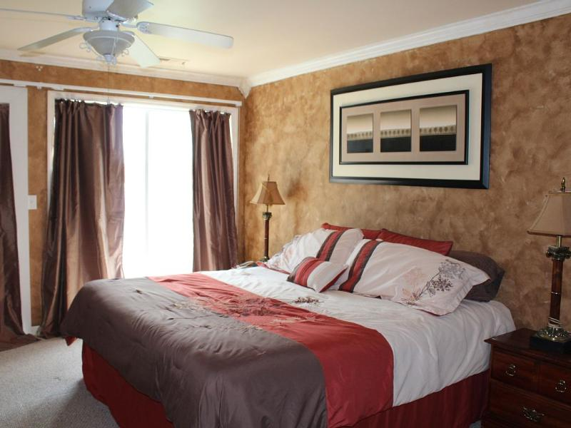 Master bedroom overlooks lake, private bath, balcony, and walk in closet.