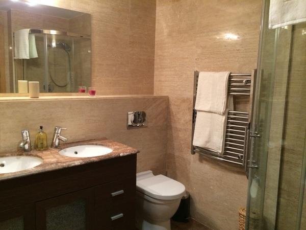 Main bathroom. Shower is to right and bath to left.