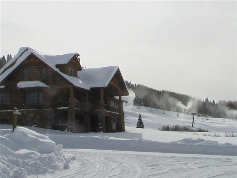 This is our house from the road. The gold link lift is in the background, which provides ski in/out
