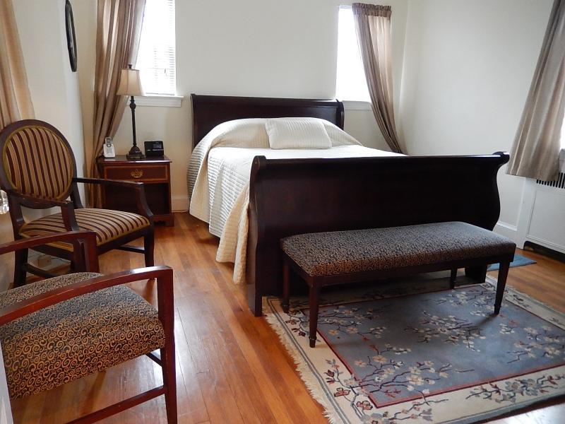 Bedroom 1: Queen sized bed, 2 nightstands, HDTV, small closet