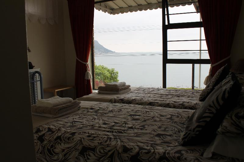 Two single beds in second bedroom, also with full sea view.