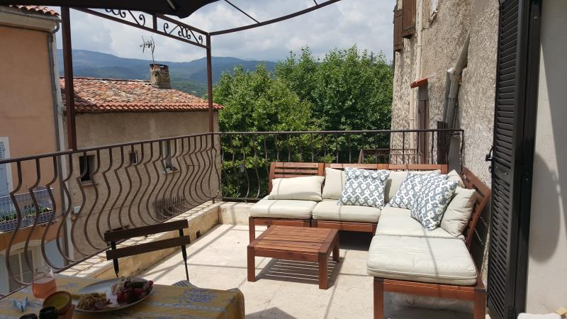 Apartment terrace overlooking the foothills of the French Alps and the village street