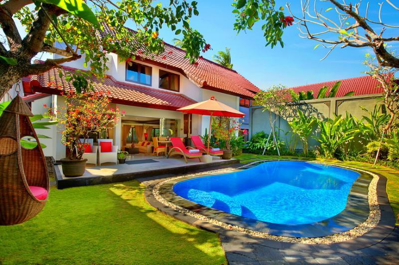 Sunbathing everyday in our big luxury swimming pool