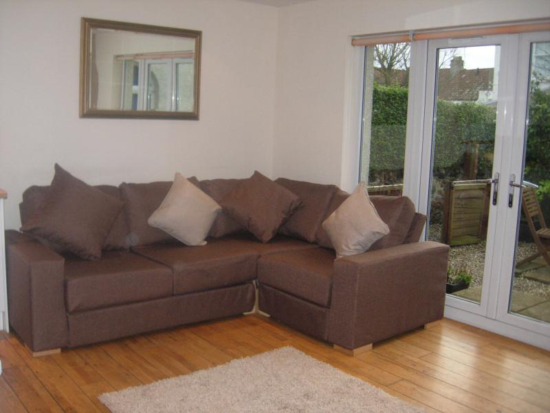 Corner sofa bed & patio doors