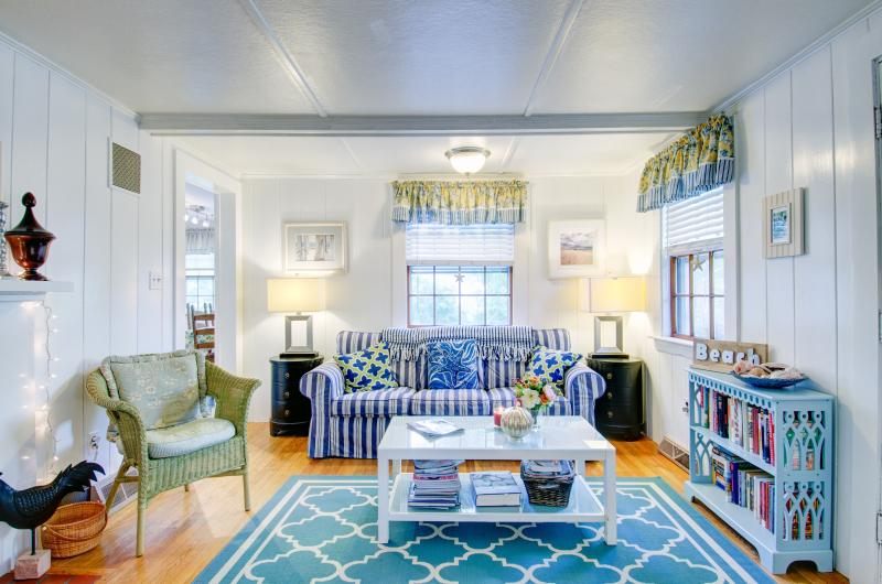 Living room with seating for 6. Classic Cape Cod décor.