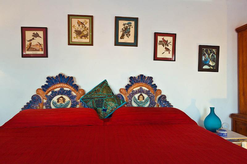 Original art pieces and hand carved painted king size headboard