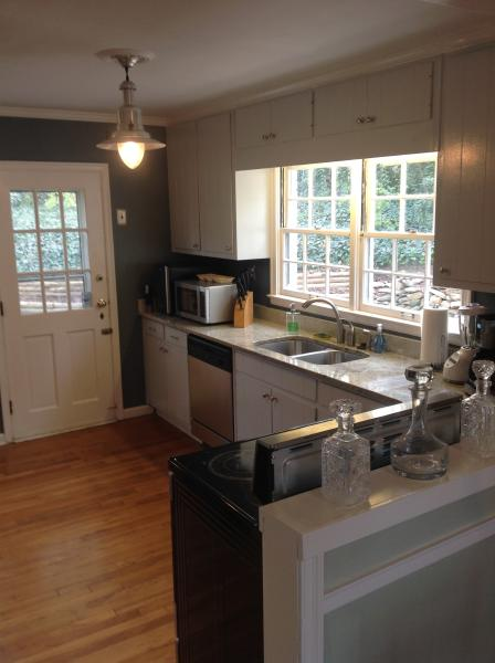 Looking into the kitchen at the granite counter tops from the living/dinning room.