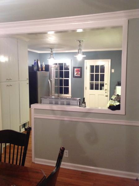 Bright, open kitchen at night perfect for relaxing wit friends while preparing a gourmet meal.