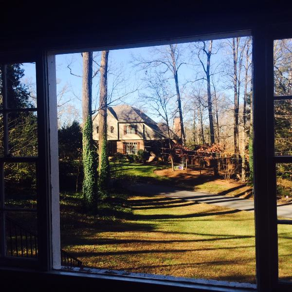 Looking out the living room bay window shows the large private lot ensuring a peaceful stay.