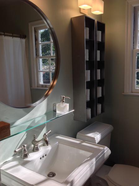Modern bathroom with new Kohler sink, toilet, fixtures, and European towels.